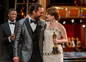 Actor Matthew McConaughey escorts winner Julianne Moore offstage as she holds her statuette for Actress in a Leading Role during the 87th Annual...