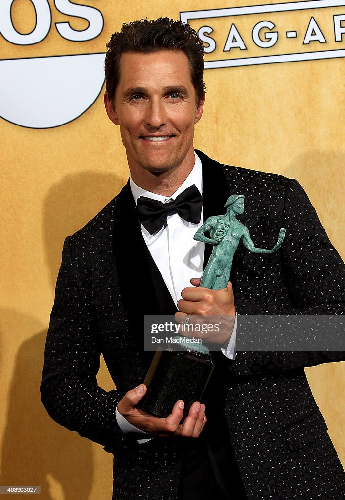Actor <a gi-track='captionPersonalityLinkClicked' href=/galleries/search?phrase=Matthew+McConaughey&family=editorial&specificpeople=201663 ng-click='$event.stopPropagation()'>Matthew McConaughey</a> poses in the press room with the award for Outstanding Performance by a Male Actor in a Leading Role for 'Dallas Buyers Club' at the 20th Annual Screen Actors Guild Awards at the Shrine Auditorium on January 18, 2014 in Los Angeles, California.