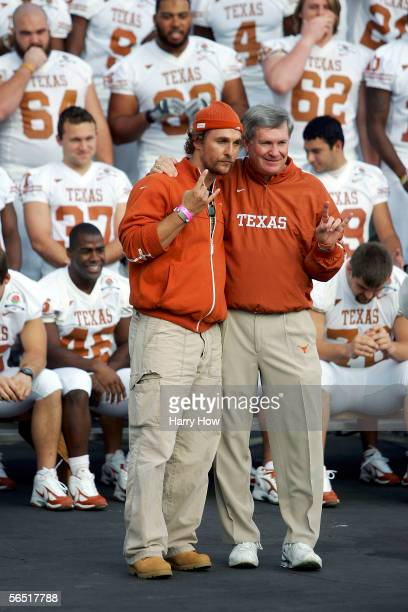 Actor Matthew McConaughey poses with University of Texas head coach Mack Brown during a team photo at the Rose Bowl January 3 2006 in Pasadena...