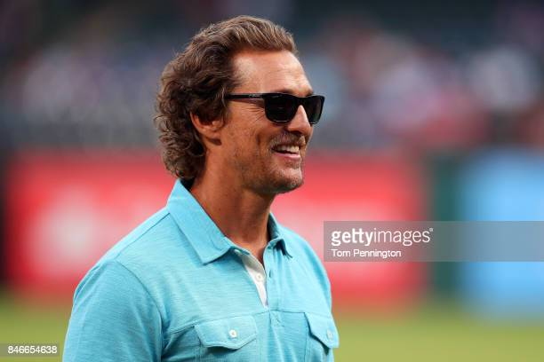 Actor Matthew McConaughey takes part in pregame activities before the Texas Rangers take on the Seattle Mariners at Globe Life Park in Arlington on...