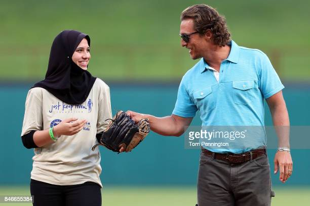 Actor Matthew McConaughey takes part in pregame activities with Samiya MohamedFawzy before the Texas Rangers take on the Seattle Mariners at Globe...