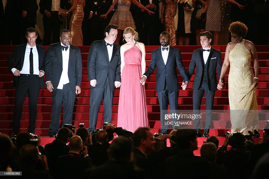 US actor Matthew McConaughey, US director Lee Daniels, US actor John Cusack, Australian actress Nicole Kidman, British actor David Oyelowo, US actor Zac Efron and US actress Macy Gray leave after the screening of 'The Paperboy' presented in competition at the 65th Cannes film festival on May 24, 2012 in Cannes. AFP PHOTO / LOIC VENANCE