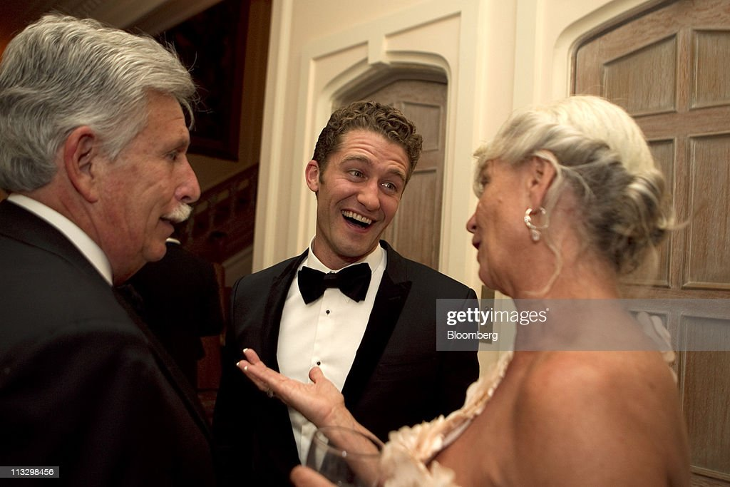 Actor <a gi-track='captionPersonalityLinkClicked' href=/galleries/search?phrase=Matthew+Morrison&family=editorial&specificpeople=171674 ng-click='$event.stopPropagation()'>Matthew Morrison</a>, center, attends the Bloomberg Vanity Fair White House Correspondents' Association (WHCA) dinner afterparty in Washington, D.C., U.S., on Saturday, April 30, 2011. The dinner raises money for WHCA scholarships and honors the recipients of the organization's journalism awards. Photographer: Andrew Harrer/Bloomberg via Getty Images
