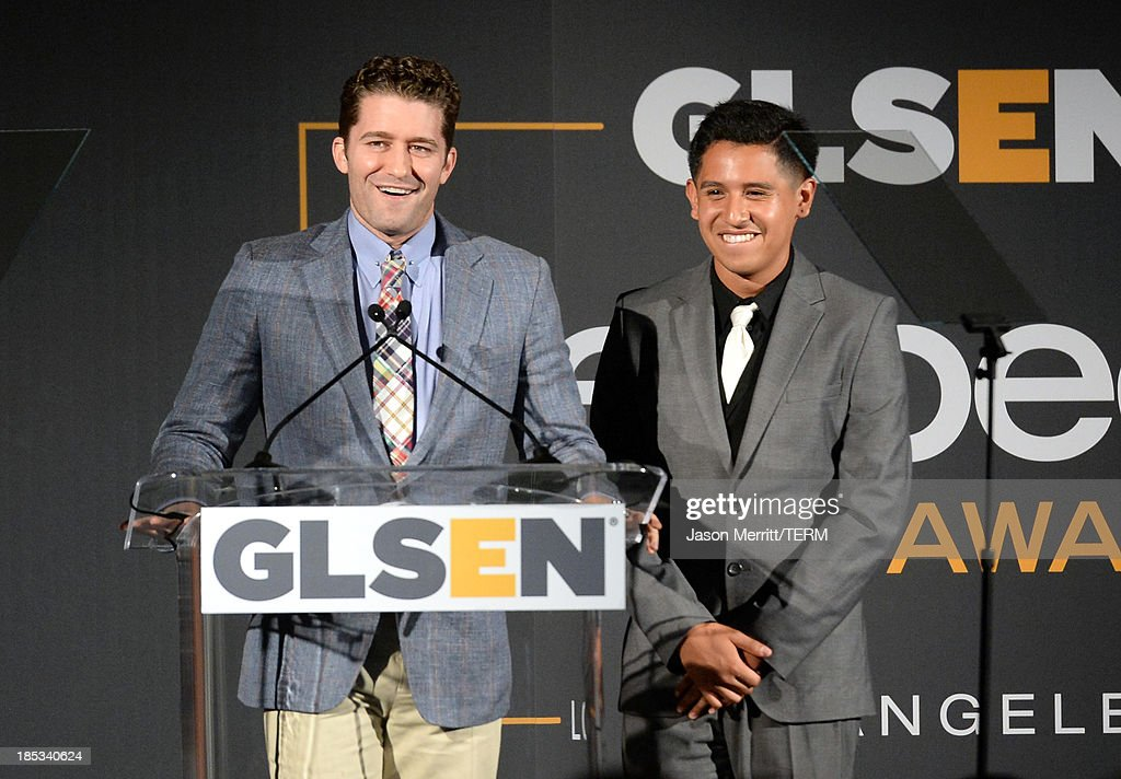 Actor <a gi-track='captionPersonalityLinkClicked' href=/galleries/search?phrase=Matthew+Morrison&family=editorial&specificpeople=171674 ng-click='$event.stopPropagation()'>Matthew Morrison</a> (L) speaks onstage during the 9th Annual GLSEN Respect Awards at Beverly Hills Hotel on October 18, 2013 in Beverly Hills, California.