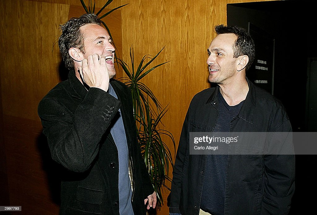 Actor Matthew Perry (R) and Actor/Director Hank Azaria (L) talk before his short film 'Nobody's Perfect' at the Writers Guild February 19, 2004 in Los Angeles, California.