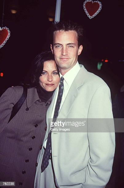 Actor Matthew Perry and television show 'Friends' costar actress Courteney Cox attend the film premiere of 'Fools Rush In' February 10 1997 in Santa...