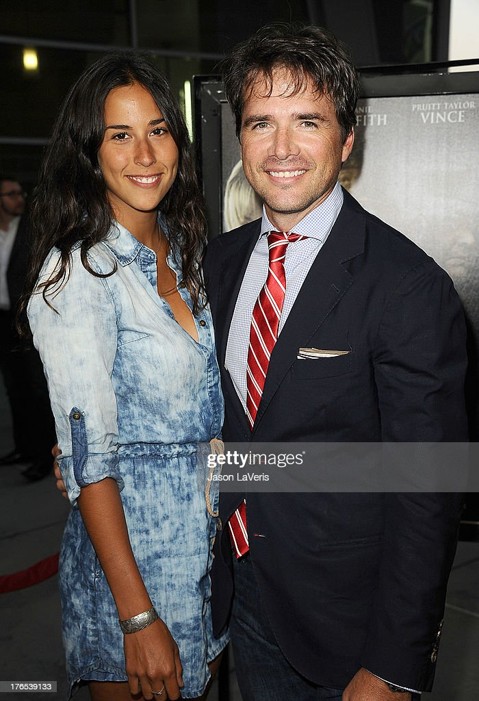 Actor <a gi-track='captionPersonalityLinkClicked' href=/galleries/search?phrase=Matthew+Settle&family=editorial&specificpeople=214670 ng-click='$event.stopPropagation()'>Matthew Settle</a> (R) and Maria Alfonsin attend the premiere of 'Dark Tourist' at ArcLight Hollywood on August 14, 2013 in Hollywood, California.