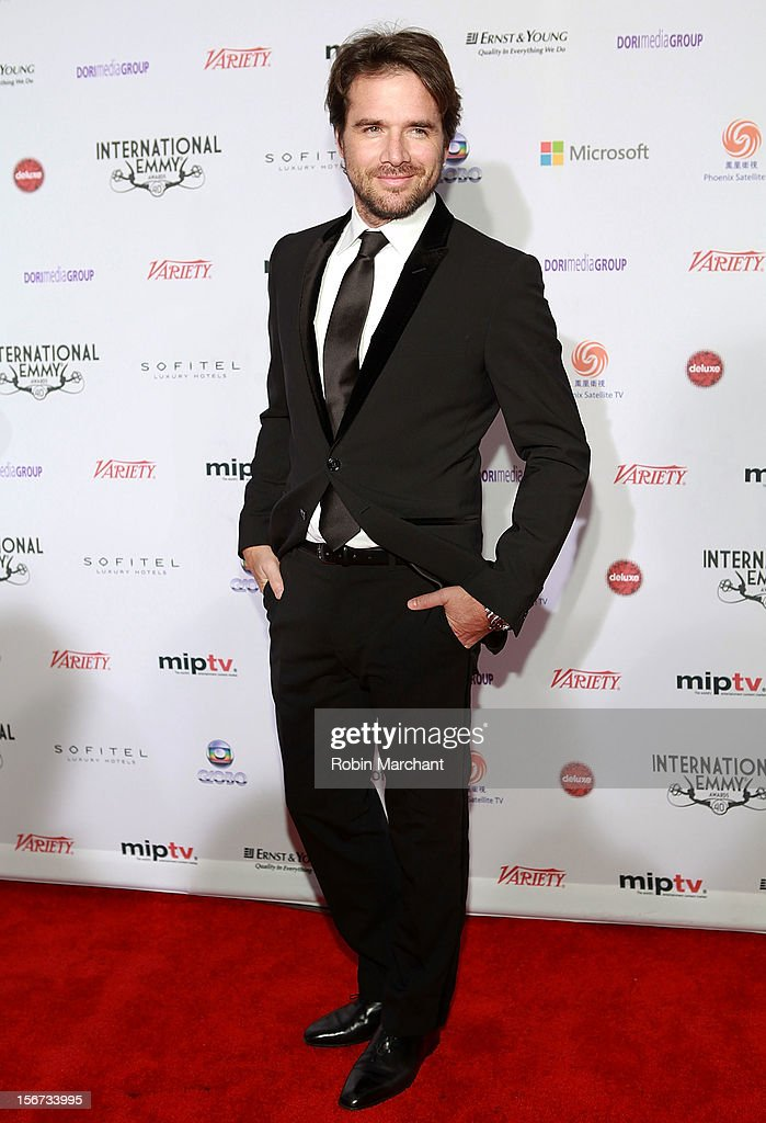 Actor <a gi-track='captionPersonalityLinkClicked' href=/galleries/search?phrase=Matthew+Settle&family=editorial&specificpeople=214670 ng-click='$event.stopPropagation()'>Matthew Settle</a> attends the 40th International Emmy Awards on November 19, 2012 in New York City.