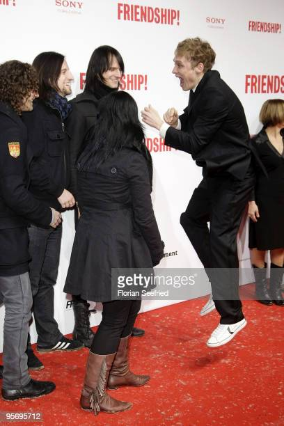 Actor Matthias Schweighoefer jumps as he meets band Silbermond at the premiere of 'Friendship' at CineMaxx at Potsdam Place on January 11 2010 in...