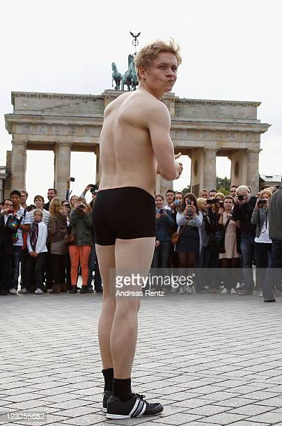 Actor Matthias Schweighoefer poses in knickers in front of the Brandenburg Gate on September 1 2011 in Berlin Germany