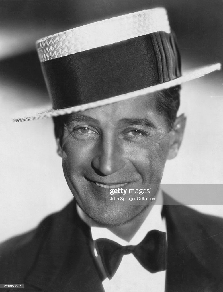 Actor <a gi-track='captionPersonalityLinkClicked' href=/galleries/search?phrase=Maurice+Chevalier&family=editorial&specificpeople=209320 ng-click='$event.stopPropagation()'>Maurice Chevalier</a> in Boater Hat and Tuxedo