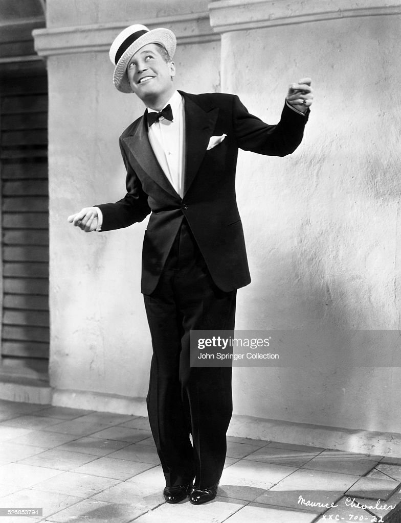 Actor <a gi-track='captionPersonalityLinkClicked' href=/galleries/search?phrase=Maurice+Chevalier&family=editorial&specificpeople=209320 ng-click='$event.stopPropagation()'>Maurice Chevalier</a> in Boaters Hat and Tuxedo