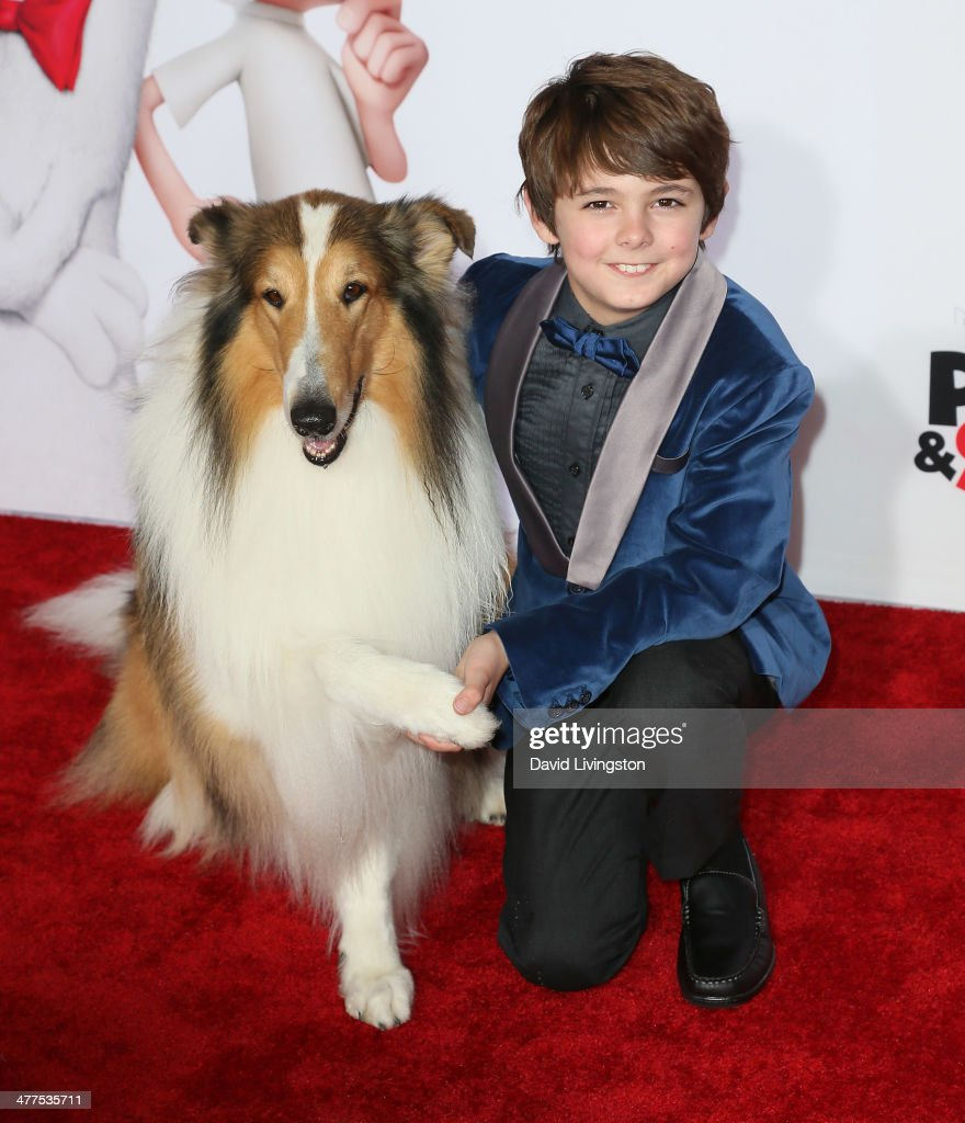 Actor Max Charles poses with Lassie at the premiere of Twentieth Century Fox and DreamWorks Animation's 'Mr Peabody Sherman' at the Regency Village...