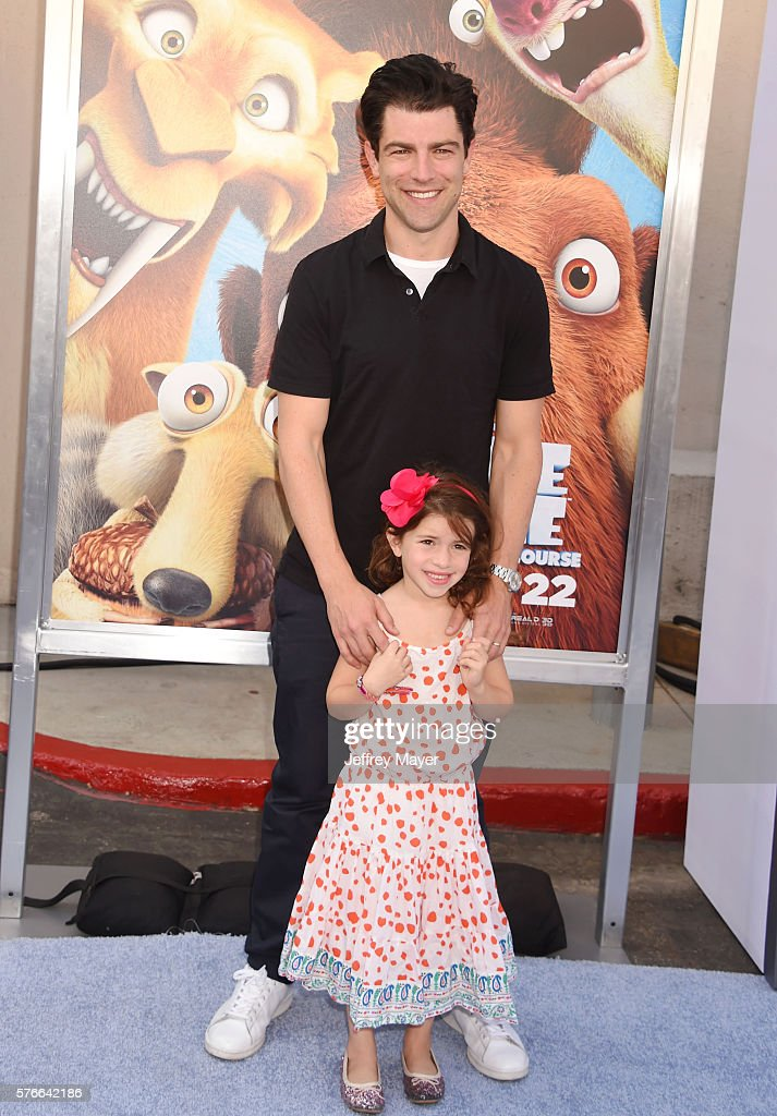 Actor Max Greenfield and daughter Lily Greenfield attend a screening of 'Ice Age Collision Course' at Zanuck Theater at 20th Century Fox Lot on July...