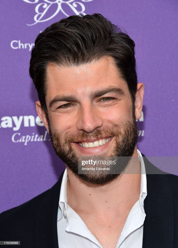 Actor <a gi-track='captionPersonalityLinkClicked' href=/galleries/search?phrase=Max+Greenfield&family=editorial&specificpeople=599135 ng-click='$event.stopPropagation()'>Max Greenfield</a> arrives at the 12th Annual Chrysalis Butterfly Ball on June 8, 2013 in Los Angeles, California.