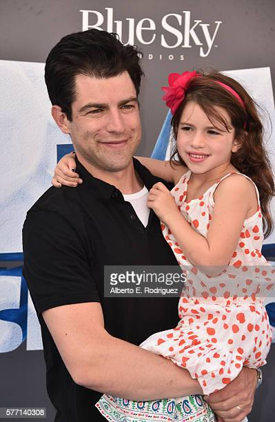 Actor Max Greenfield with daughter Lilly Greenfield attend the screening of 'Ice Age Collision Course' at Zanuck Theater at 20th Century Fox Lot on...