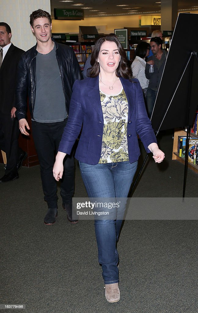 Actor Max Irons (L) and author Stephenie Meyer attend a signing for Meyer's book 'The Host' at Barnes & Noble bookstore at The Grove on March 15, 2013 in Los Angeles, California.