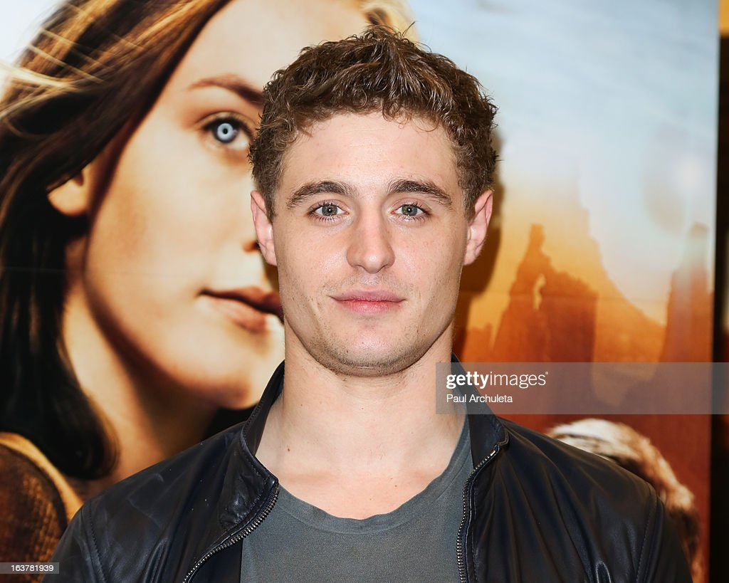 Actor <a gi-track='captionPersonalityLinkClicked' href=/galleries/search?phrase=Max+Irons&family=editorial&specificpeople=762929 ng-click='$event.stopPropagation()'>Max Irons</a> signs copies of 'The Host' at Barnes & Noble bookstore at The Grove on March 15, 2013 in Los Angeles, California.