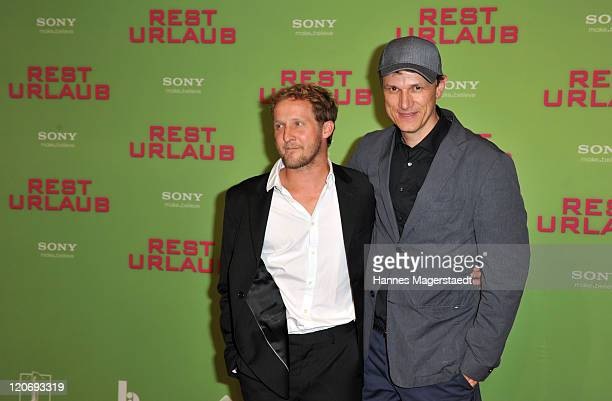 Actor Maximilian Brueckner and Gregor Schnitzler attend Germany Premiere 'Resturlaub' at the Mathaeser Filmpalast on August 8 2011 in Munich Germany