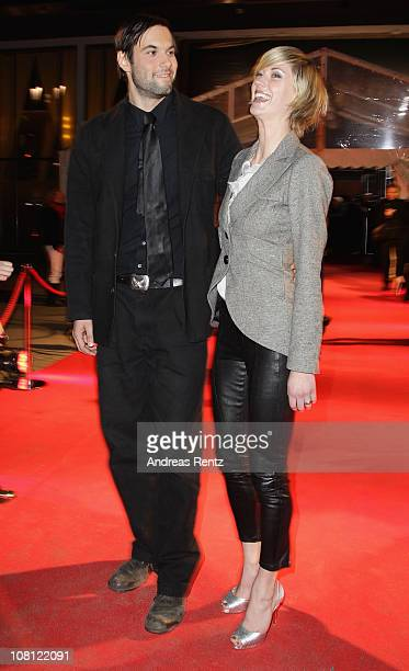 Actor Maximilian Simonischek and actress Lauren Lee Smith arrive for the Hindenburg premiere at Kosmos theater on January 18 2011 in Berlin Germany