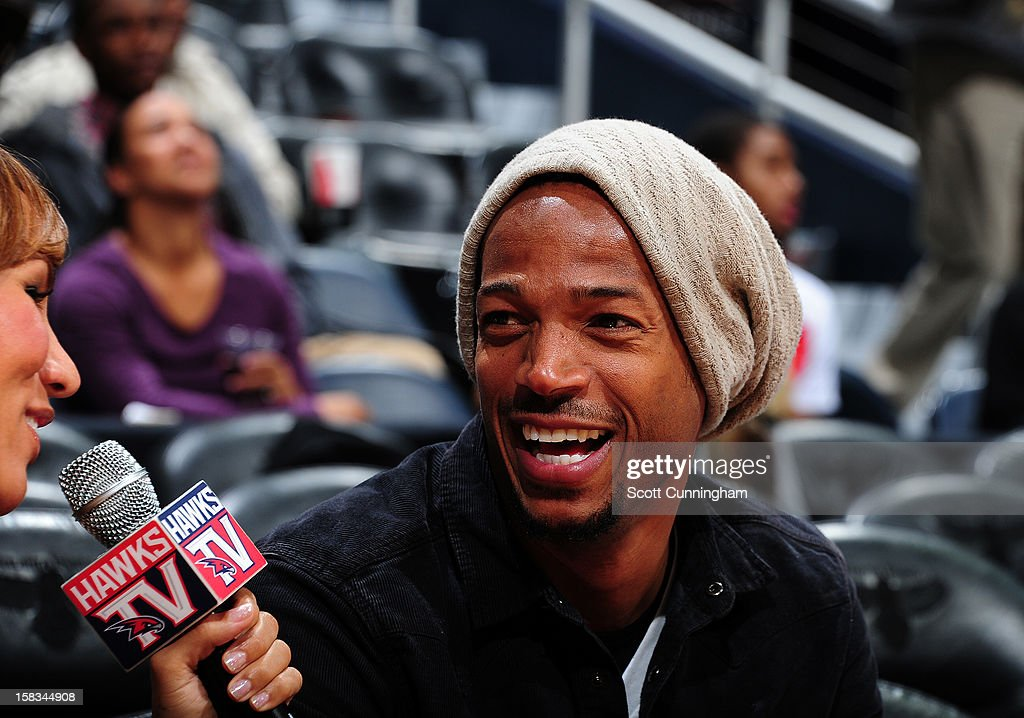 Actor Maylon Wayans gets interviewed during the Atlanta Hawks , Charlotte Bobcats game at Philips Arena on December 13 ,2012 in Atlanta, Georgia.