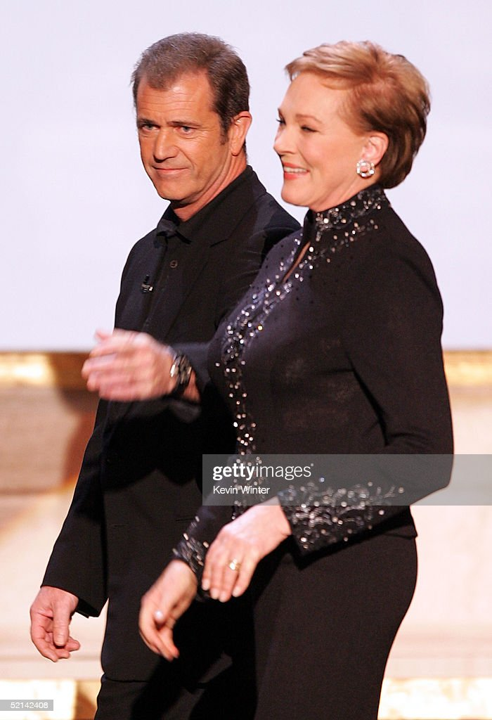 Actor Mel Gibson (L) and Actress Julie Andrews onstage during the 11th Annual Screen Actors Guild Awards at the Los Angeles Shrine Exposition Center on February 5, 2005 in Los Angeles, California.