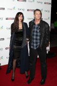 Actor Mel Gibson and fiance Oksana Grigorieva arrive at The Hollywood Reporter Reception Honoring Oscar Nominees at The Getty House on March 4 2010...