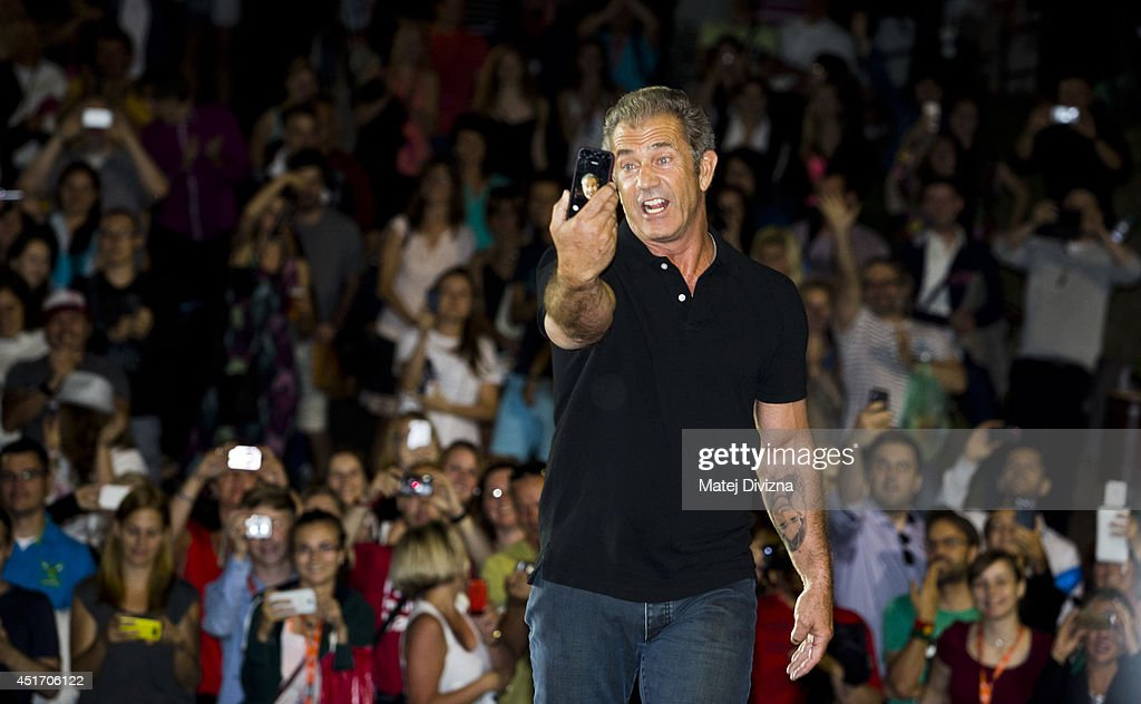 Actor Mel Gibson takes selfie as he puts on outdoor screening of 'Mad Max' film during the 49th Karlovy Vary International Film Festival on July 4...