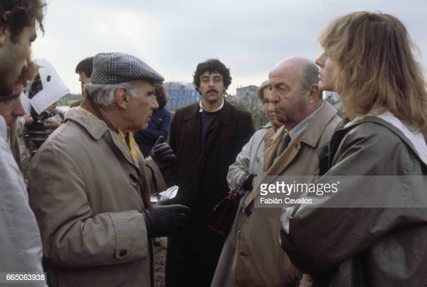 Actor Meme Perlini looks on as director Luigi Comencini discusses a scene with actor Bernard Blier while filming the 1980 picture Voltati Eugenio The...