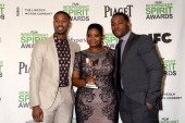 Actor Michael B Jordan actress Octavia Spencer and director Ryan Coogler pose with the award for Best First Feature for 'Fruitvale Station' in the...