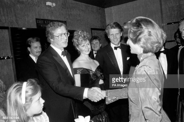 Actor Michael Caine meets the Duchess of Gloucester at the Odeon cinema in London's Haymarket The Duchess was attending the charity premiere of his...