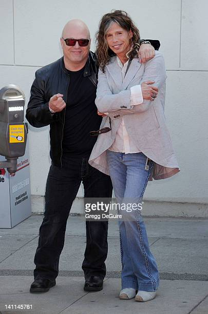 Actor Michael Chiklis and musician Steven Tyler arrive at John Varvatos 9th Annual Stuart House Benefit at John Varvatos Los Angeles on March 11 2012...