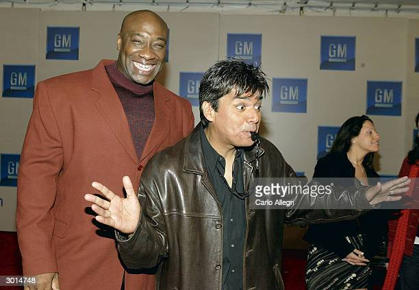 Actor Michael Clarke Duncan and actor/comedian George Lopez gesture as they arrive for the 3rd Annual 'ten' fashion show and charity event to...