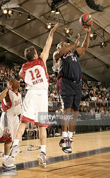 Actor Michael Clarke Duncan shoots over actor James Denton during the McDonald's NBA AllStar Celebrity Game Presented by 2K Sports at NBA Jam Session...