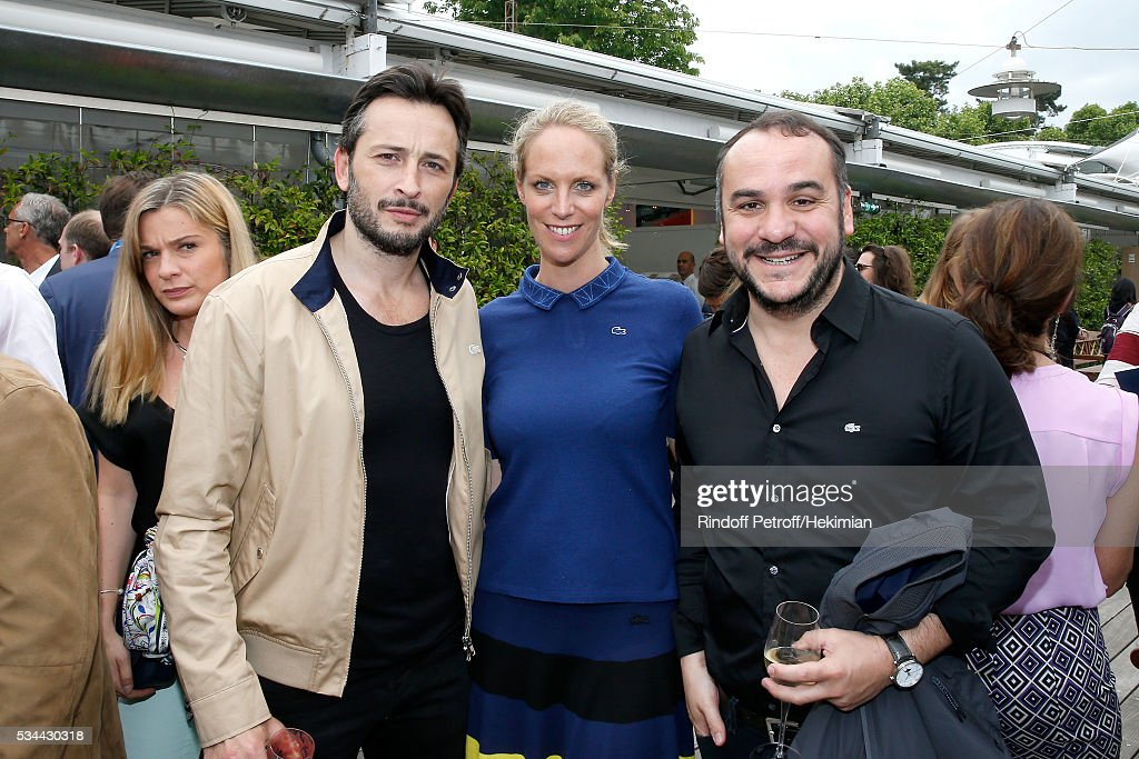 Actor Michael Cohen, Head Public Relations & investment products of Lacoste, Johanne Gilbert and actor Francois Xavier Demaison attend the 2016 French Tennis Open - Day Four at Roland Garros on May 25, 2016 in Paris, France.