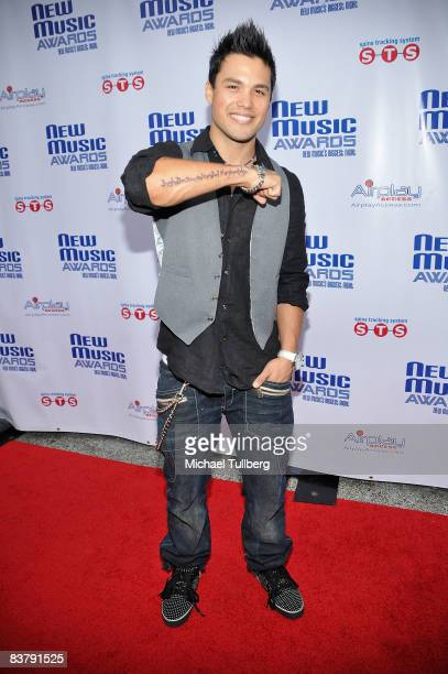 Actor Michael Copon shows off a tattoo on his arm of Albert Einstein's quote 'Imagination is more important than knowledge' at the New Music Weekly...