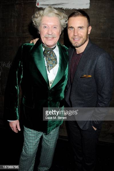 Actor Michael Crawford and singer Gary Barlow celebrate Michael's 70th birthday backstage following a performance of 'The Wizard Of Oz' at the London...