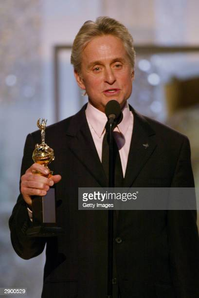 Actor Michael Douglas accepting his Cecil B DeMille Award on stage at the 61st Annual Golden Globe Awards on January 25 2004 at the Beverly Hilton...