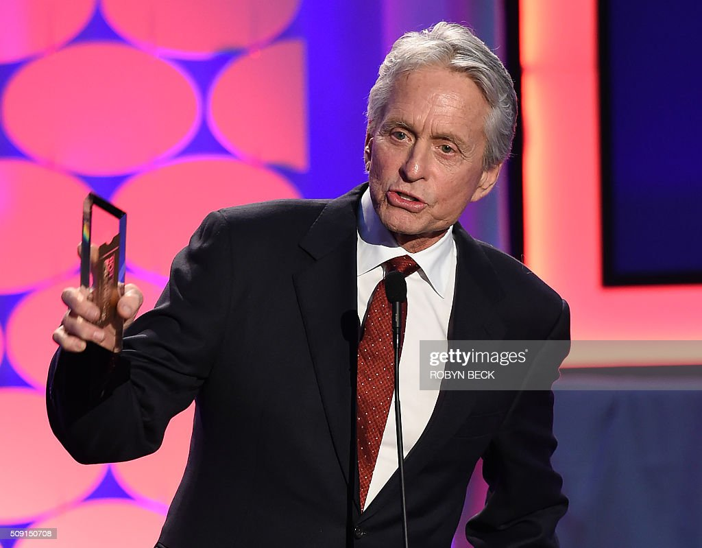 Actor Michael Douglas accepts the Career Achievement Award on stage at the AARP 15th Annual Movies For Grownups Awards, February 8, 2016, at the Beverly Wilshire Hotel in Beverly Hills, California. / AFP / ROBYN BECK