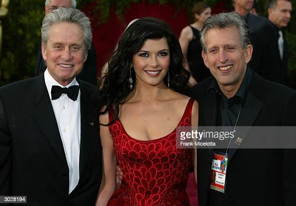 Actor Michael Douglas actress Catherine ZetaJones and Producer Joseph Roth attend the 76th Annual Academy Awards at the Kodak Theater on February 29...