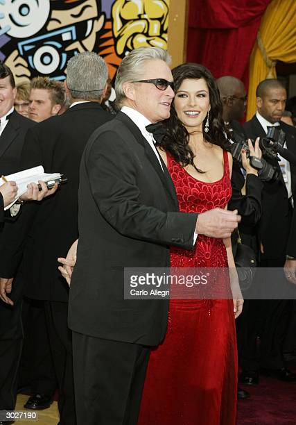 Actor Michael Douglas and Actress Catherine ZetaJones attends the 76th Annual Academy Awards at the Kodak Theater on February 29 2004 in Hollywood...