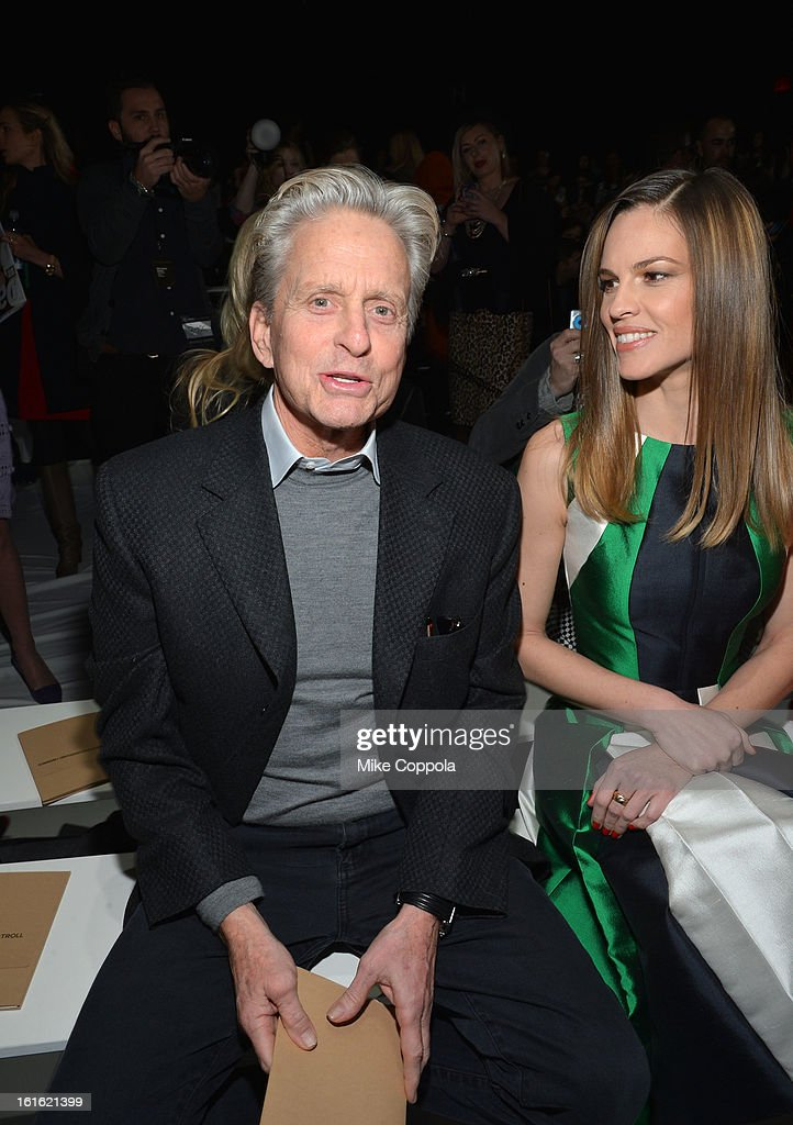 Actor <a gi-track='captionPersonalityLinkClicked' href=/galleries/search?phrase=Michael+Douglas&family=editorial&specificpeople=171111 ng-click='$event.stopPropagation()'>Michael Douglas</a> (L) and actress <a gi-track='captionPersonalityLinkClicked' href=/galleries/search?phrase=Hilary+Swank&family=editorial&specificpeople=201692 ng-click='$event.stopPropagation()'>Hilary Swank</a> attend the Michael Kors Fall 2013 fashion show during Mercedes-Benz Fashion Week at The Theatre at Lincoln Center on February 13, 2013 in New York City.