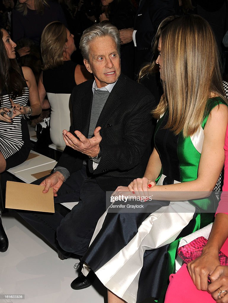 Actor <a gi-track='captionPersonalityLinkClicked' href=/galleries/search?phrase=Michael+Douglas&family=editorial&specificpeople=171111 ng-click='$event.stopPropagation()'>Michael Douglas</a> and Actress <a gi-track='captionPersonalityLinkClicked' href=/galleries/search?phrase=Hilary+Swank&family=editorial&specificpeople=201692 ng-click='$event.stopPropagation()'>Hilary Swank</a> front row during the Michael Kors Fall 2013 Mercedes-Benz Fashion Show at The Theater at Lincoln Center on February 13, 2013 in New York City.