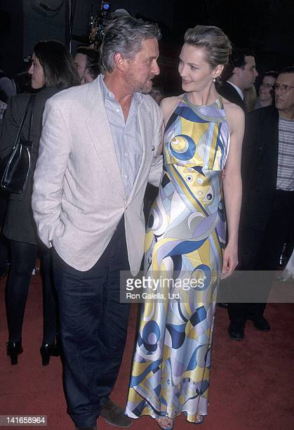 Actor Michael Douglas and actress Joan Allen attend the 'Face/Off' Hollywood Premiere on June 19 1997 at the Mann's Chinese Theatre in Hollywood...
