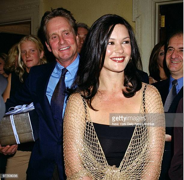 Actor Michael Douglas and Catherine ZetaJones arrive at a 48th birthday party for actor Christopher Reeve paralyzed from the shoulders down in a 1995...