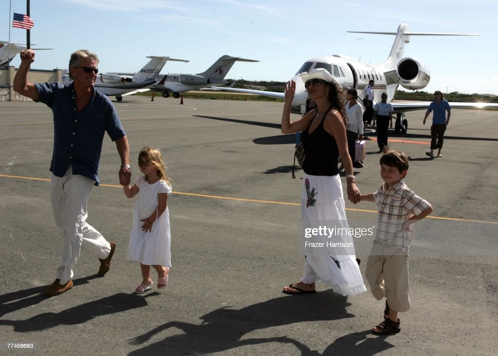 (Actor <a gi-track='captionPersonalityLinkClicked' href=/galleries/search?phrase=Michael+Douglas&family=editorial&specificpeople=171111 ng-click='$event.stopPropagation()'>Michael Douglas</a> and Catherine Zeta-Jones with children Carys (31/2) and Dylan (6) arrive at the Provo Airport before travelling to Callis Islands while the Douglas family is on holiday in the Caribean January 5, 2007 in Providenciales Turks and Caicos Islands. (Photo by Frazer Harrison/Getty Images).
