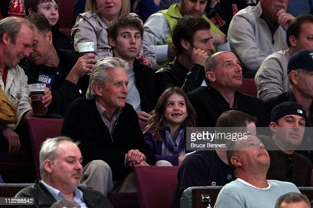 Actor Michael Douglas and his daughter Carys watch the New York Rangers play against the Washington Capitals in Game Three of the Eastern Conference...