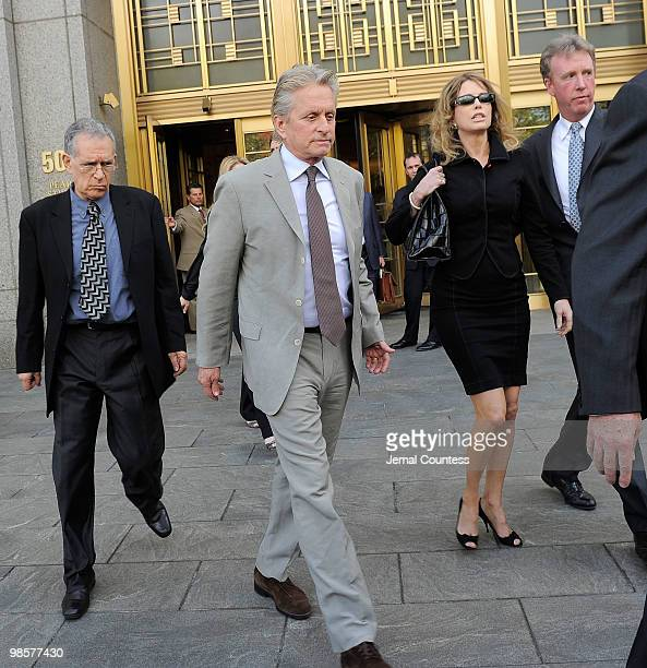Actor Michael Douglas and his exwife producer Diandra Douglas depart the US District Court building following the sentencing of their son Cameron...