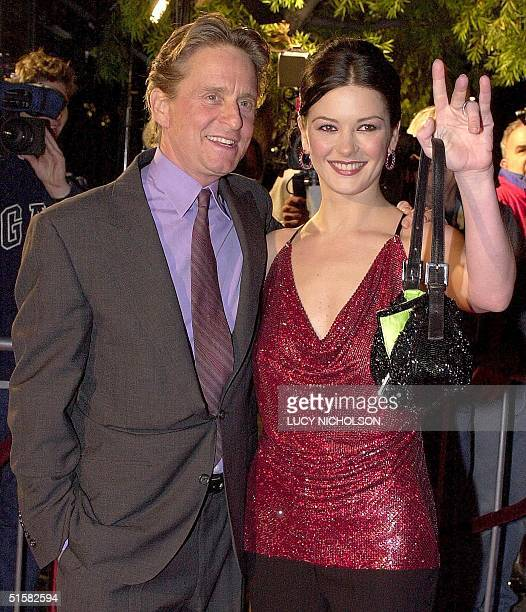 US actor Michael Douglas and his newly wed wife Welsh actress Catherine ZetaJones arrive at the premiere of their new film 'Traffic' in Beverly Hills...