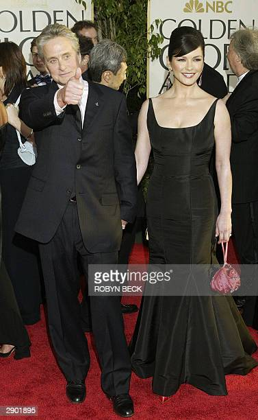 US actor Michael Douglas and his wife actress Catherine ZetaJones arrive for the Golden Globe Awards ceremony 25 January 2004 at the Beverly Hilton...